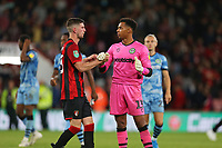 Football - 2019 / 2020 EFL Carabao (League) Cup - Second Round: AFC Bournemouth vs. Forest Green Rovers<br /> <br /> Bournemouth's Chris Mepham commiserates Joe Wollacott of Forest Green Rovers after the keeper saved one penalty in the shoot out but still lost at the Vitality Stadium (Dean Court) Bournemouth <br /> <br /> COLORSPORT/SHAUN BOGGUST