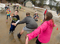 Peter and Abby run through Austin to tag Kirby during parking lot games with the Meredith Parks and Recreation Day Camp for February vacation week.  (Karen Bobotas/for the Laconia Daily Sun)