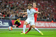 England's Luke Shaw shields the ball from Switzerland's Stephan Lichsteiner  during the UEFA European 2016 Qualifying match between England and Switzerland at Wembley Stadium, London, England on 8 September 2015. Photo by Shane Healey.