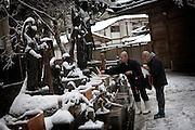 (En) January 2010 - Koyasan, Japan.  Near the Tamagawa holy river in the Oku-no-In cimetery, pilgrims bring thin pieces of wood (mizumeke toba) as an offering to bodhisattvas (Jizo, Fudo and Kannon). The piece of wood is then purified with water and fire. (Fr) Janvier 2010 - Koyasan, Japon. Pres de la riviere sacree Tamagawa dans le cimetiere de l'Oku-no-in, les pelerins offrent de fines plaques de bois (mizumeke toba) devant les statues des divinites bouddhistes (Jizo, Fudo et Kannon) avant de les purifier par le feu et l'eau.
