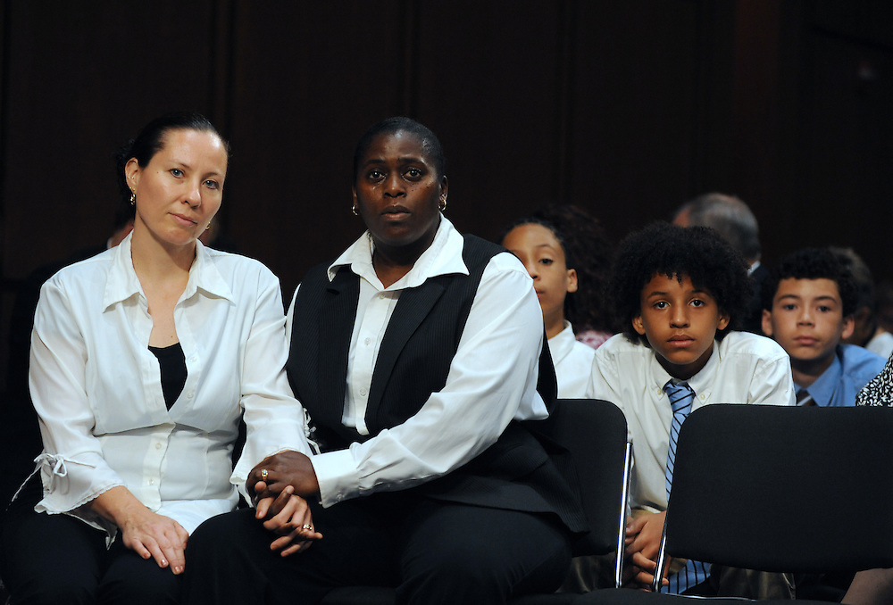 "Geraldine and Suzanne Artis, of Clinton, Conn., hold hands during a hearing entitled ""S.598, The Respect for Marriage Act: Assessing the Impact of DOMA on American Families."" Solmonese is among the witnesses to testify in the hearing. The Artis' have been together for 17 years and have three sons (left to right) Zanagee, 11, Gezani, 11, and Geras, 13."