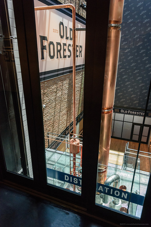 The back wall of the elevator offers a view into the atrium with the gift area at the bottom and the 44 foot-tall column still made by Vendome Copper & Brass Works of Louisville, Ky., in the center of the view in the Old Forester Distilling Company on Whisky Row in Louisville, Ky. June 6, 2018