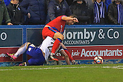 Steven Davies sits on Shaun Beeney during the The FA Cup 3rd round match between Barrow and Rochdale at Holker Street, Barrow, United Kingdom on 7 January 2017. Photo by Daniel Youngs.