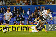 Johnny Russell is tackled by Michael Morrison during the Sky Bet Championship match between Birmingham City and Derby County at St Andrews, Birmingham, England on 21 August 2015. Photo by Alan Franklin.