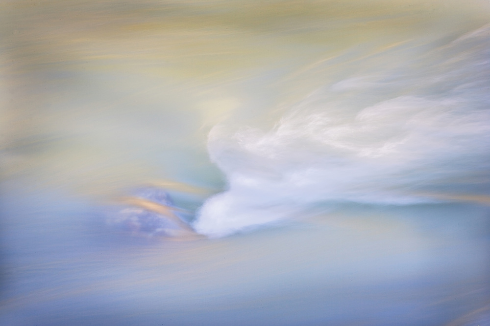 Soft Abstract of Water Flowing Over Rock in River, CA.