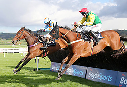 Jockey Robbie Power on board Fox Norton (nearside) wins the BoyleSports Champion Chase during day one of the Punchestown Festival in Naas, Co. Kildare.