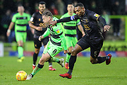 Forest Green Rovers Dayle Grubb(8) and Mansfield Town's Krystian Bishop(5) during the EFL Sky Bet League 2 match between Forest Green Rovers and Mansfield Town at the New Lawn, Forest Green, United Kingdom on 15 December 2018.