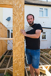 Alan Street stands at the place where his £4,000 sliding doors would have been at the front of an extension he was having built for his Hornchurch, Essex home, only for the company constructing it to cease trading, leaving him thousands of pounds out of pocket and with planning headaches to solve after the builders failed to seek the proper permissions for the piles on which the structure would stand. Hornchurch, Essex, July 29 2019.