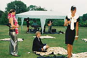 Guests drinking on the lawn, while a band play in a small marquee, Posh at Addington Palace, UK, August, 2004