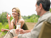 Man and woman sitting drinking selective focus