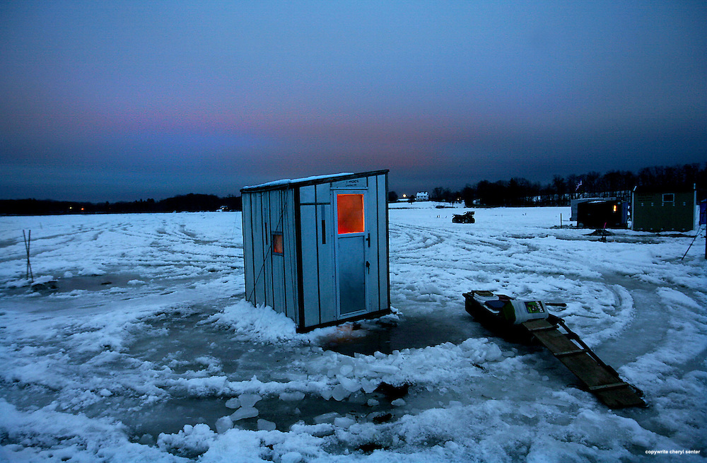 An ice shack glows with interior warmth as the sun sets on Great Bay in Newington, N.H. Sunday,  January, 24, 2010.  (Portsmouth Herald Photo/Cheryl Senter)