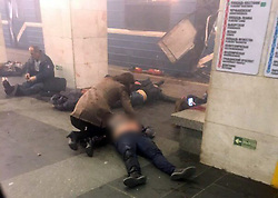 April 3, 2017  - St Petersburg, Russia - The scene immediately after the blast with people on the ground at Sennaya metro station in St. Petersburg. A suspected bomb detonated on a metro train in St Petersburg on Monday, killing at least 10 people. The blast occurred at the Sennaya Ploshchad station, in the centre of Russia's second city, at about 2.30pm, reportedly as the train was pulling out of the station. (Credit Image: © Xinhua via ZUMA Wire)
