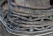 A Garter snake winds itself through a rubber mat.