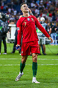Portugal forward Cristiano Ronaldo (7) celebrates with the fans at full time after winning the UEFA Nations League match between Portugal and Netherlands at Estadio do Dragao, Porto, Portugal on 9 June 2019.
