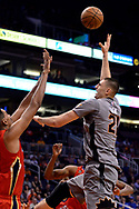 Feb 13, 2017; Phoenix, AZ, USA; Phoenix Suns center Alex Len (21) shoots the ball over New Orleans Pelicans center Alexis Ajinca (42) in the first half of the NBA game at Talking Stick Resort Arena. Mandatory Credit: Jennifer Stewart-USA TODAY Sports