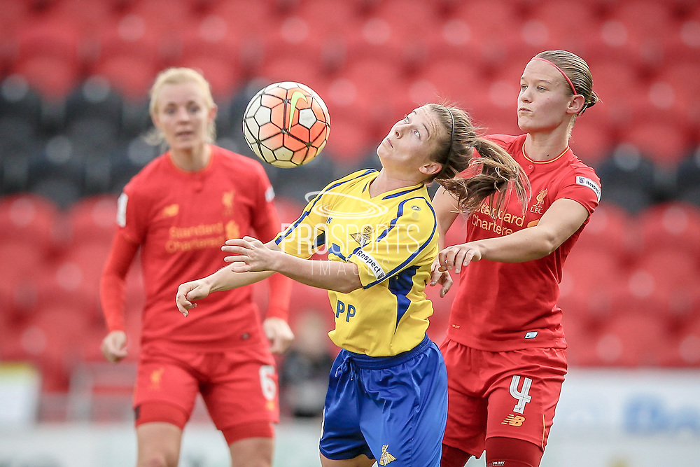 Christie Murray (Doncaster Rovers Belles) controls the ball while Mandy van den Berg (Liverpool Ladies FC) marks her during the FA Women's Super League match between Doncaster Rovers Belles and Liverpool Ladies at the Keepmoat Stadium, Doncaster, England on 9 October 2016. Photo by Mark PDoherty.