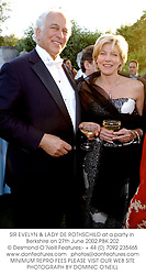 SIR EVELYN & LADY DE ROTHSCHILD at a party in Berkshire on 27th June 2002.		PBK 202