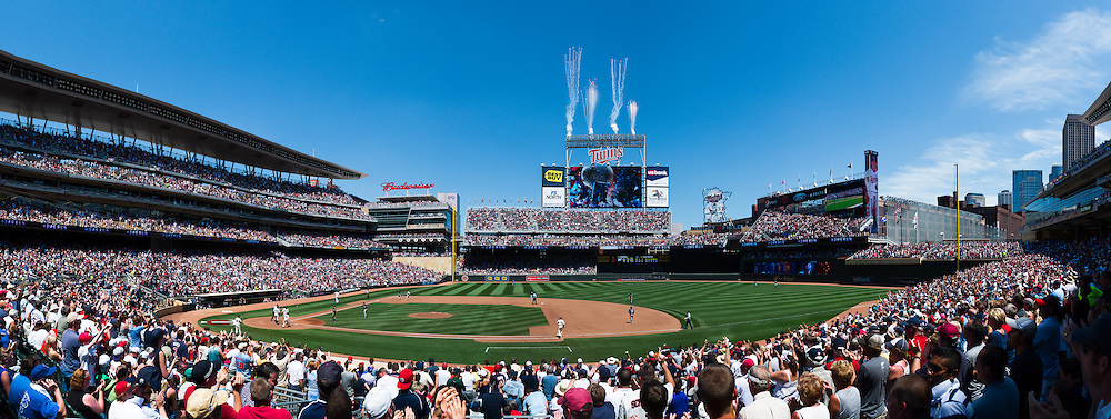 [Note:  This panorama was stitched from multiple photos during post-processing] Fireworks go off as Minnesota Twins left fielder Rene Tosoni rounds the bases after hitting a 3-run homerun against the Milwaukee Brewers on July 3, 2011 at Target Field in Minneapolis, Minnesota.  The Twins won the game 9 to 7.
