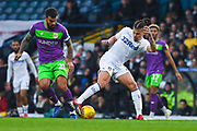 Kalvin Phillips of Leeds United (23) Cryuff turns the ball away from Marlon Pack of Bristol City (21) during the EFL Sky Bet Championship match between Leeds United and Bristol City at Elland Road, Leeds, England on 24 November 2018.