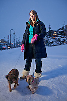 "Jayme Keller with her dogs, Daphne and Sophie, in front of State of Alaska Court House, downtown, Anchorage.  ""Daphne and Sophie refused to go outside because of the deep snow, so I brought them downtown because I knew it would be cleared."""