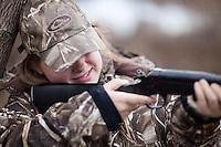 YOUNG GIRL DUCK HUNTER SHOOTING A ROSSI 20 GAUGE SINGLE SHOT SHOTGUN