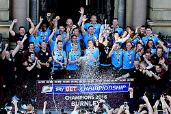 Burnley players lift the SkyBet Championship Winners trophy in front of their fans outside the Town Hall - Mandatory by-line: Matt McNulty/JMP - 09/05/2016 - FOOTBALL - Burnley Town Hall - Burnley, England - Burnley FC Championship Trophy Presentation