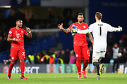 Bayern Munich goalkeeper Manuel Neuer runs to Bayern Munich defender Jerome Boateng and Bayern Munich defender David Alaba after the Champions League match between Chelsea and Bayern Munich at Stamford Bridge, London, England on 25 February 2020.