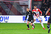 Jordan Williams of Barnsley (22) and Danny Andrew of Doncaster Rovers (3) in action during the EFL Sky Bet League 1 match between Doncaster Rovers and Barnsley at the Keepmoat Stadium, Doncaster, England on 15 March 2019.