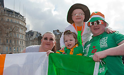 © Licensed to London News Pictures. 18/03/2012. London, England. An Irish family celebrates in Trafalgar Square. London celebrates St. Patrick's Day with a parade and festival. Photo credit: Bettina Strenske/LNP