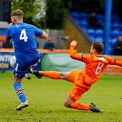 Braintrees Billy Crook tries to get the ball around Gloucesters Matt Williams during the Vanorama National League South match between Braintree Town FC and Gloucester City FC at the IronmongeryDirect Stadium, Essex on 28 April 2018. Photo by Matt Bristow.