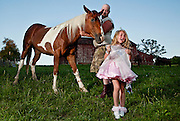 Laughing only moments before with her father, Little Miss Chauncey Dover, Heidi Jo McGrady, 6, screams only after realizing that her favorite horse, Freckles, chewed-up and stained her new dress, on Sunday, May 31, 2009, in front of her Logan, Ohio, home.