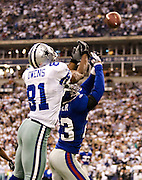 IRVING, TX - JANUARY 13:   Terrell Owens #81 of the Dallas Cowboys tries to catch a pass over Corey Webster #23 of the New York Giants during the NFC Divisional playoff at Texas Stadium on January 13, 2008 in Dallas, Texas.  The Giants defeated the Cowboys 21-17.  (Photo by Wesley Hitt/Getty Images) *** Local Caption *** Terrell Owens