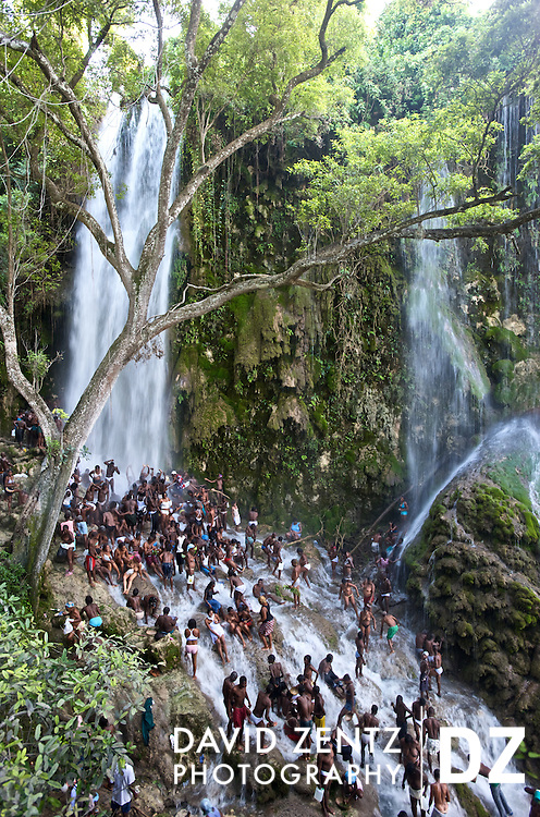 Thousands of voodou worshippers bathe in the waters of Saut D'eau in central Haiti during the annual three day festival there in mid-July. Pilgrims come to honor the Virgin Mary or la vyej, her voodou counterpart, Ezili Freda, as well as Danbala, the great serpentine lord of the waterfall, and other lwas, or spirits.