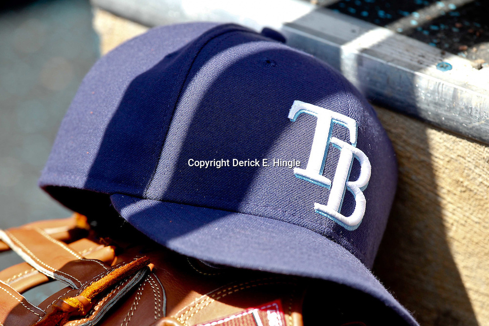 March 21, 2012; Port Charlotte, FL, USA; A detail of a Tampa Bay Rays hat and glove in the dugout for a spring training game against the New York Yankees at Charlotte Sports Park.  Mandatory Credit: Derick E. Hingle-US PRESSWIRE
