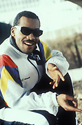 Daddy Freddy DX wearing black shades and colourful sweatshirt, U.S.A, 1990.