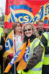 Sue Harrison Branch Representative with PCS (Right)..Members PCS union hold a rally outside Nick Cleggs Constituency Office, to raise awareness of the fact that this month will see the first  increased contributions coming out of their salaries to pay for the changes to public sector pensions. It is the first in a series of hands off our pensions red card protest outside key ministerial constituencies over the Easter recess...http://www.pauldaviddrabble.co.uk.14 April 2012 .Image © Paul David Drabble
