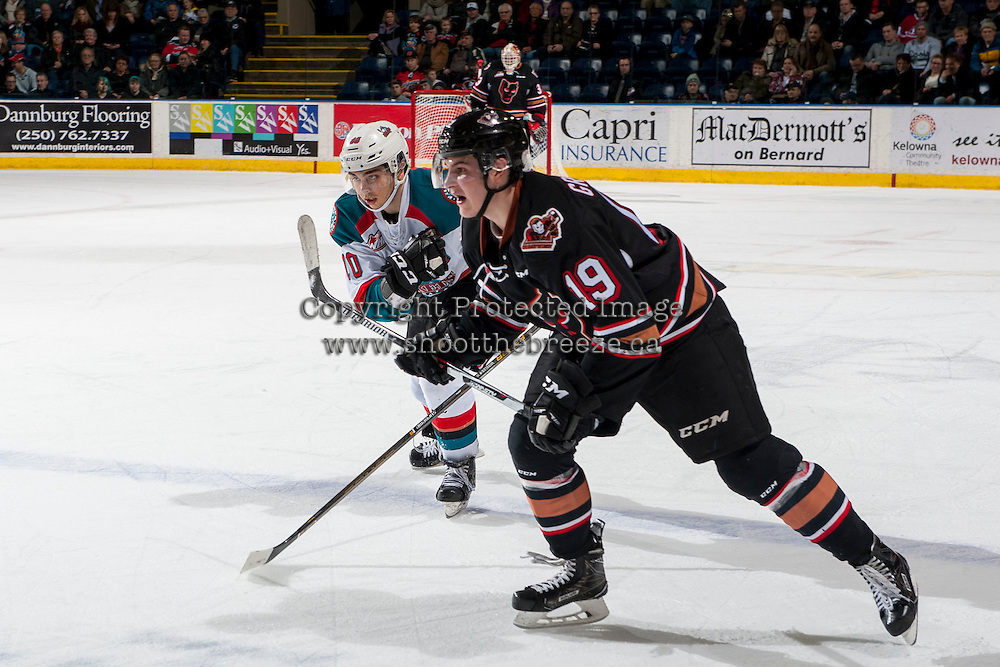 KELOWNA, CANADA - FEBRUARY 1: Andrei Grishakov #19 of the Calgary Hitmen checks Nick Merkley #10 of the Kelowna Rockets on February 1, 2017 at Prospera Place in Kelowna, British Columbia, Canada.  (Photo by Marissa Baecker/Shoot the Breeze)  *** Local Caption ***