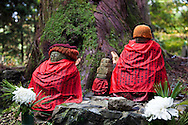 Red clad jizos at Okunoin,  considered one of the most sacred places in Japan. People from all over Japan, who wished to be buried close to Kobo Daishi, lie there, including former feudal lords, politicians and other prominent personalities. Their graves line the approaches to Okunoin for several hundred meters through the forest.