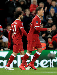 Liverpool's Roberto Firmino (right) celebrates scoring his side's first goal of the game during the Emirates FA Cup, fourth round match at Anfield, Liverpool.