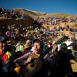 Men play the guitar and sing in Coyllurqui, in Apurimac, Peru, during the celebrations of Yawar Fiesta. This Peruvian tradition, that takes place annually in July during the Independence day celebrations, consists of capturing a condor and parading around town throughout the week. The highlight of the tradition is bullfighting with the condor strapped on top of the bull. For locals, the bull represents the Spanish and the condor the native population. The condor is freed in a ceremony called Cacharpari.
