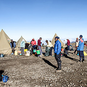 Porters getting ready to pack up camp at Moir Hut Camp (13,660 feet) on Mt Kilimanjaro's Lemosho Route.