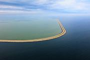 Nederland, Flevoland, IJsselmeer, 22-05-2011; Houtribdijk verbindt Enkhuizen en Lelystad en deelt het IJsselmeer in IJsselmeer en Markermeer (links). De foto is gemaakt richting Enkhuizen. De Houtribdijk is oorspronkelijk aangelegd om het Markeermeer in te polderen tot Markerwaard. De plannen voor deze inpoldering maakte reeds deel uit van de Zuiderzeewerken. Andere namen voor de dijk zijn: Markerwaarddijk, Lelydijk, Dijk Enkhuizen-Lelystad, N302..Houtrib dike linking Enkhuizen and Lelystad, dividing lake IJsselmeer in IJsselmeer and Marker lake(left). The photo was taken towards Enkhuizen. .The dike was originally built make the reclamation of the polder Markerwaard possible. The plans for the reclamation was already part of the Zuiderzee Works (1891)..luchtfoto (toeslag), aerial photo (additional fee required).foto/photo Siebe Swart