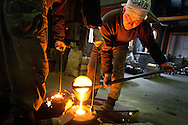 Preparing the molten iron, prior to casting into molds to make teapots, at the Iwachu Casting Works in Morioka city, Iwate prefecture, Japan, on Thursday 26th January 2012.