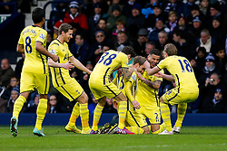 Christian Eriksen of Tottenham Hotspur celebrates with Ryan Mason, Kyle Walker and Harry Kane after scoring a goal from a free kick to make it 0-1 - Photo mandatory by-line: Rogan Thomson/JMP - 07966 386802 - 31/01/2015 - SPORT - FOOTBALL - West Bromwich, England - The Hawthorns - West Bromwich Albion v Tottenham Hotspur - Barclays Premier League.