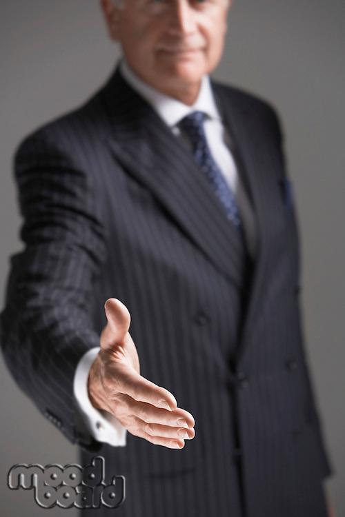 Businessman Offering Hand half length