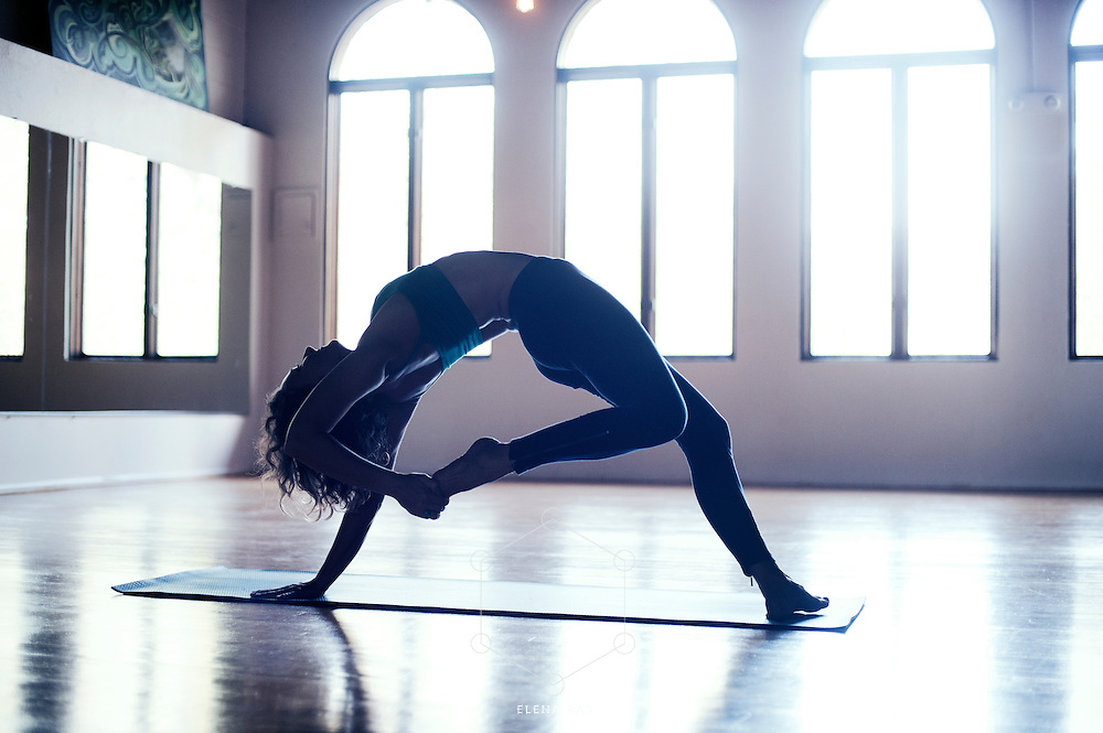 Remember, this is your legend.<br /> <br /> :::::::::::::::::::::::::::::::::::::::::::::::::::::::::::<br /> <br /> <br /> Woman practicing yoga in a beautiful studio.