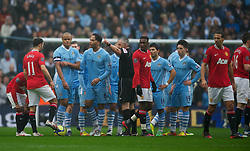 MANCHESTER, ENGLAND - Sunday, January 8, 2012: Manchester City's Vincent Kompany is shown the red card and sent off by referee Chris Foy during the FA Cup 3rd Round match against Manchester United at the City of Manchester Stadium. (Pic by David Rawcliffe/Propaganda)