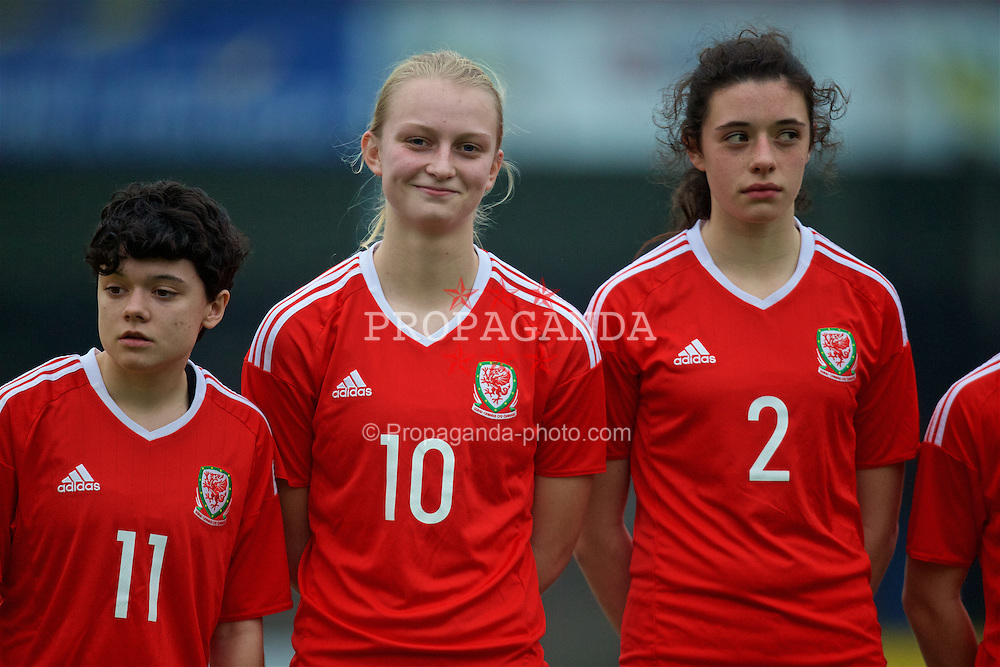 MERTHYR, WALES - Tuesday, February 14, 2017: Wales' Emily Jones, Elise Hughes and Thierry-Jo Gauvain line-up before a Women's Under-17's International Friendly match against Hungary at Penydarren Park. (Pic by Laura Malkin/Propaganda)