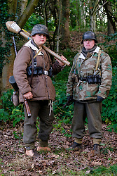 Reenactors dressed in late War German winter clothing both are wearing Parkas and Steel helmets, Short Boots and Gaiters carrying the Mauser K98 Rifle. One also has a Panzerfaust antitank weapon<br /> <br />  September 2019<br /> All Images Copyright Paul David Drabble - <br /> All rights Reserved - <br /> Moral Rights Asserted -