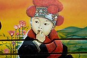 Painting of hill tribe child on bus in Northern Thailand.